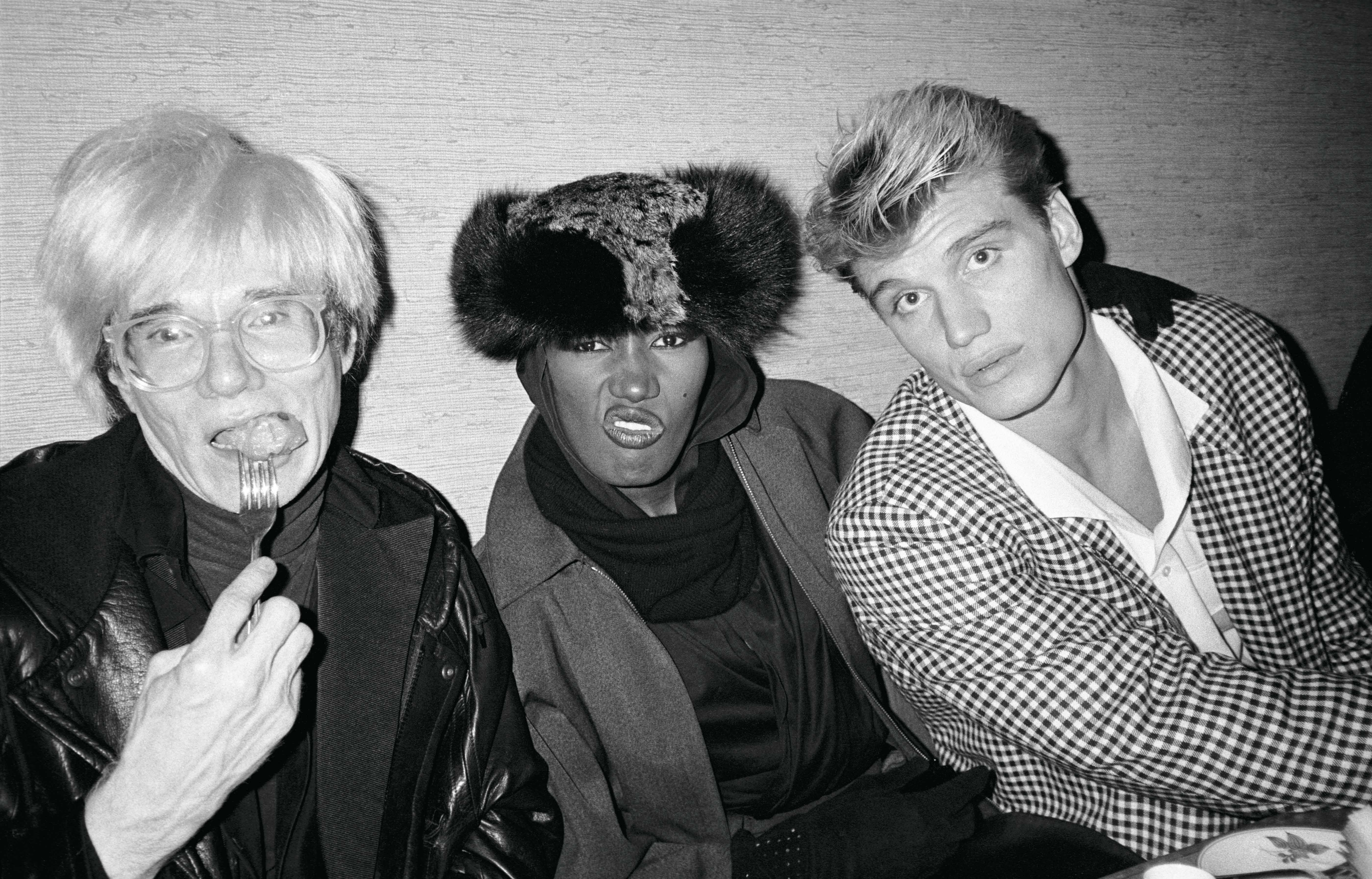 Andy Warhol, Grace Jones and actor Dolph Lundgren at Nippon in 1985, courtesy of Paige Powell. <em>Paige Powell</em> is now available at Gucci Wooster bookstore.